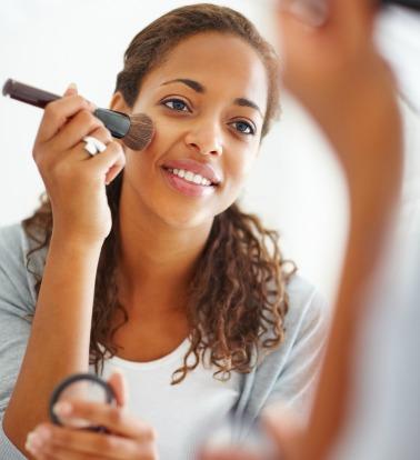 Black-woman-applying-makeup-